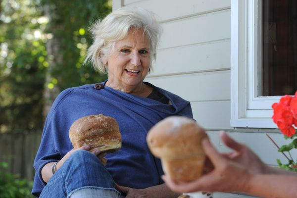 Debbie Jaso delivered whole wheat honey bread with cranberries that she baked for her friend Linda Vollertsen on Tuesday, June 16, 2020. (Bill Roth / ADN)