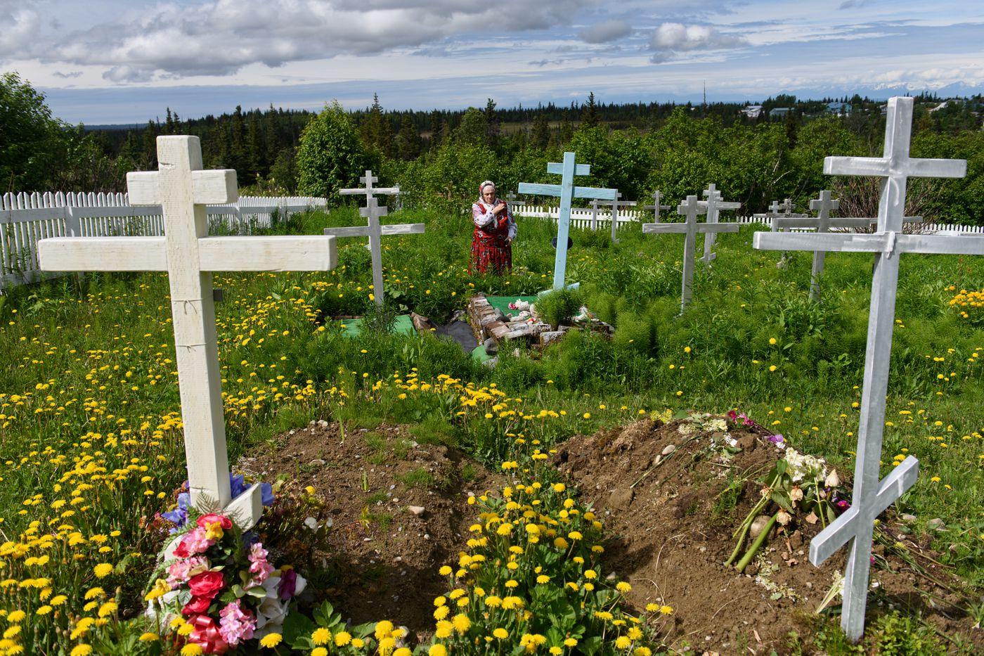 Nina Fefelov visits her mother Maria Kiselyova's grave at the Nikolaevsk cemetery. (Marc Lester / ADN)