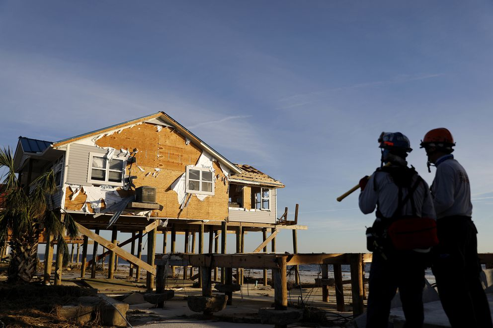 A home stands damaged from hurricane Michael as members of a South Florida urban search and rescue team look for survivors in Mexico Beach, Fla., Friday, Oct. 12, 2018. (AP Photo/David Goldman)