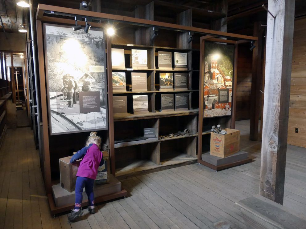 A child looks at exhibits at Kennecott. (Photo by Rosemarie Salazar / NPS)