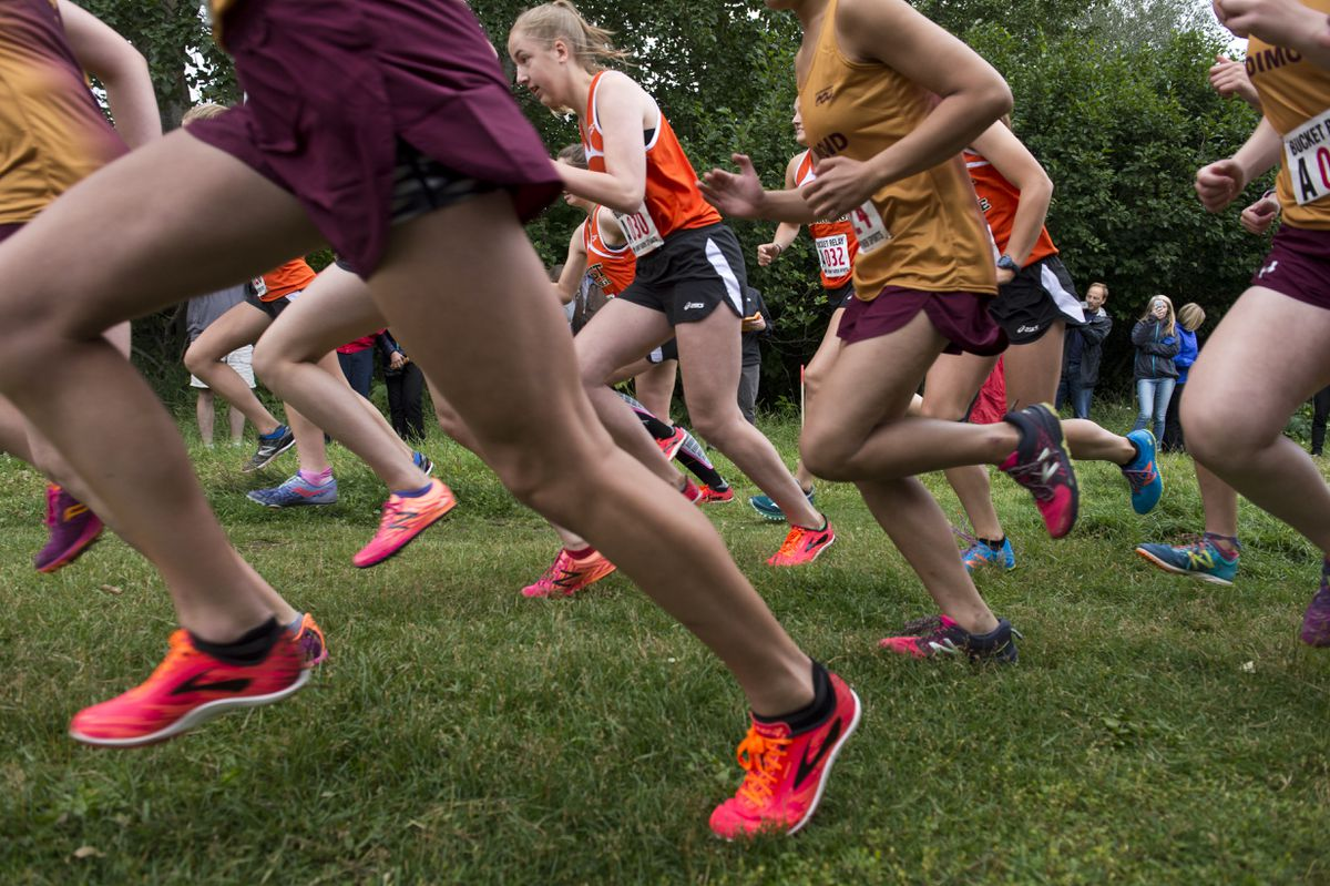 Runners in the first leg of the girls race leave the starting line Tuesday at Kincaid Park. (Marc Lester / ADN)