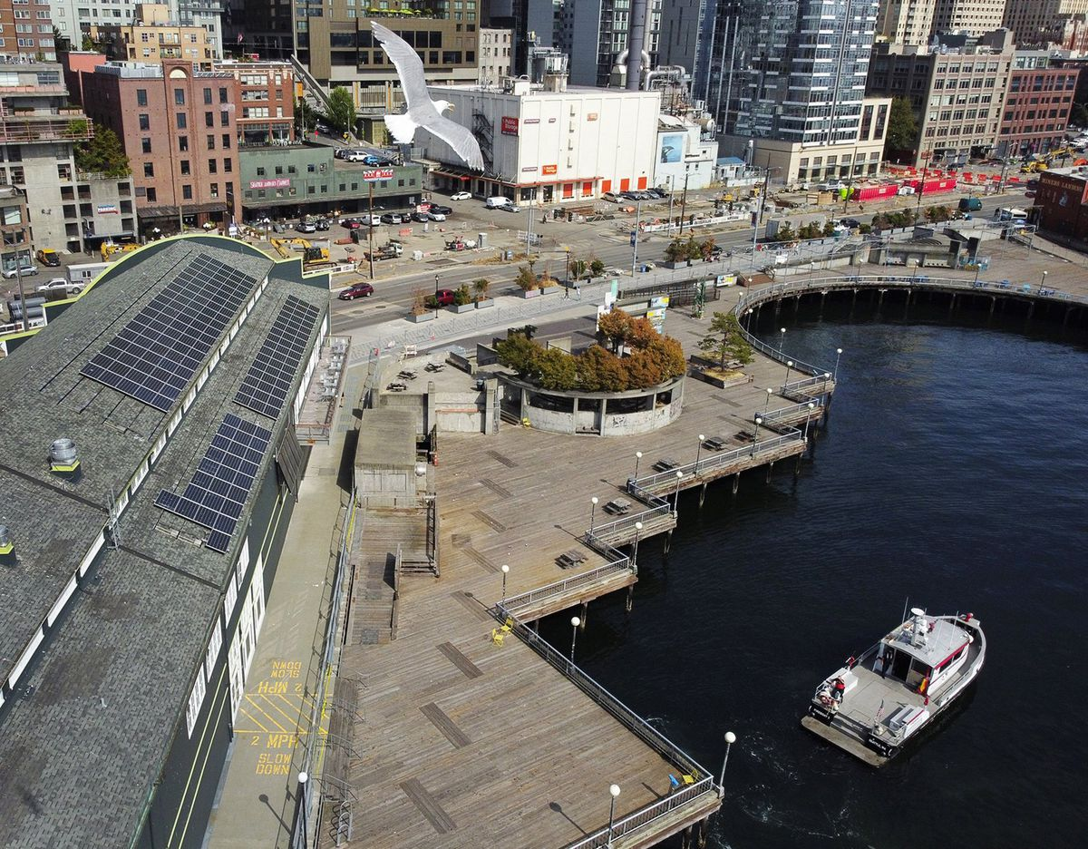 Seattle's old Waterfront Park on August 11, 2020, after the city closed it the previous week upon discovering Pier 58 had shifted, leaving a gap between the pier and the land. It partially collapsed on Sunday, Sept. 13, 2020. The Seattle Aquarium is on the left.(Ken Lambert/Seattle Times/TNS)