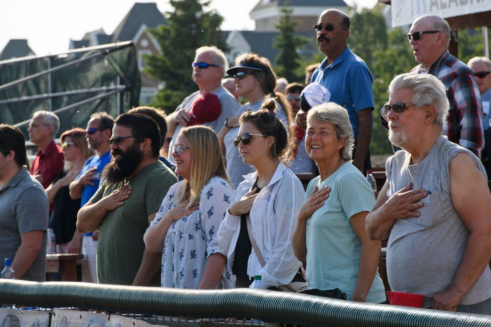Fans stand as the national anthem is sung at the start of a Pilots game. (Marc Lester / ADN)