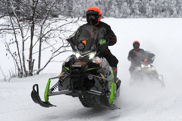 Twenty-seven two-person teams hit the trail during the Iron Dog start at Big Lake on Sunday, Feb 18, 2018. Racers will travel over 2,000 miles of wilderness from Big Lake to Nome and a Fairbanks finish on Saturday. (Bill Roth/ ADN)