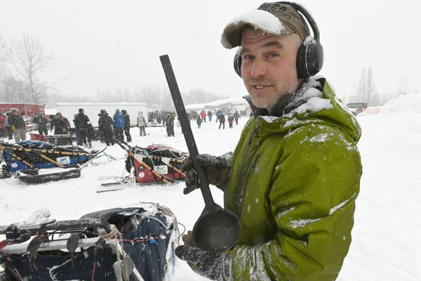 Iditarod veteran Lev Shvarts of Willow holds a carbon fiber ladle that he manufactures and will be using to feed his dogs during the Iditarod Trail Sled Dog Race. Sunday, March 8, 2020. (Bill Roth / ADN)