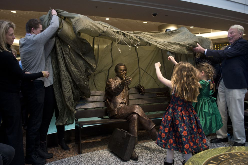 Family and friends of Ted Stevens unveil the statue at Ted Stevens Anchorage International Airport. (Marc Lester / ADN)