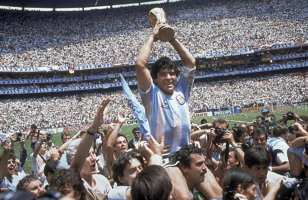 FILE - In this June 29, 1986, file photo, Diego Maradona holds up his team's trophy after Argentina's 3-2 victory over West Germany at the World Cup final soccer match at Azteca Stadium in Mexico City. The Argentine soccer great who was among the best players ever and who led his country to the 1986 World Cup title died from a heart attack on Wednesday, Nov. 25, 2020, at his home in Buenos Aires. He was 60. (AP Photo/Carlo Fumagalli, File)