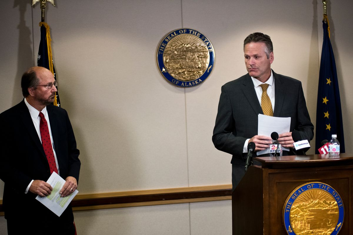 Gov. Mike Dunleavy, right, asks Attorney General Kevin Clarkson to step to the podium on September 26, 2019. (Marc Lester / ADN)
