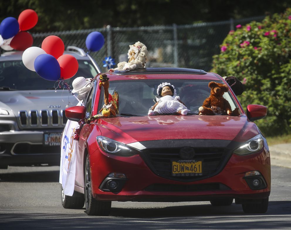 A decorated car takes part in a parade, helping celebrate seniors living at Chugach View and Chugach Manor. (Emily Mesner / ADN)