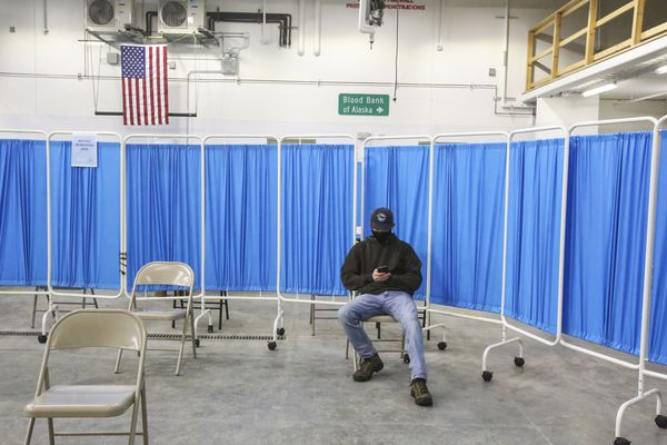 Kyle Wolner, 20, sits in the monitoring area after receiving his first dose of the Pfizer-BioNTech COVID-19 vaccine at the Blood Bank of Alaska in Anchorage on March 10, 2021. (Emily Mesner / ADN)