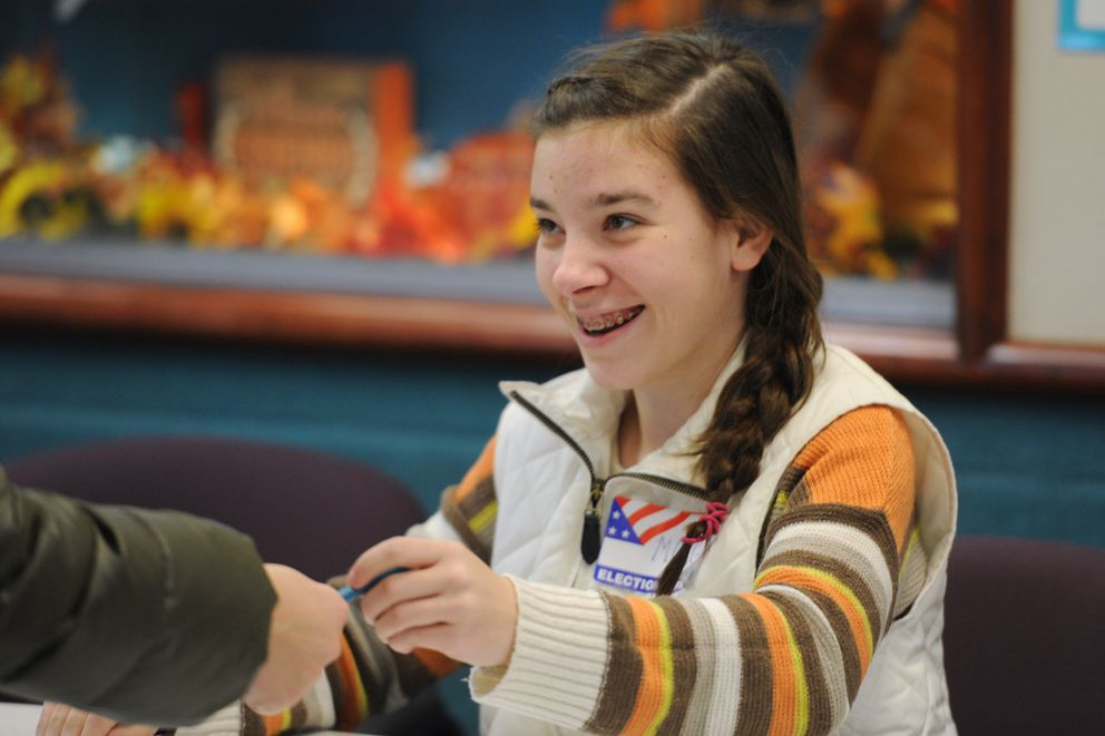"Election official Morgan Bolan, 16, a junior at Bartlett High took the day off from school to sign in voters on Election Day, Tuesday, Nov. 6, 2018. When asked why Bolan said, ""I feel like it's my civic duty."" (Bill Roth / ADN)"