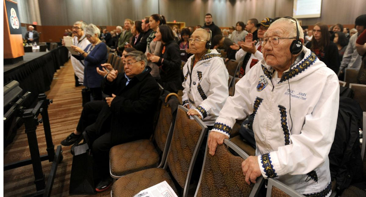 Elders Peter Morre and Paul John listen to Yup'ik translated from English at the annual Alaska Federation of Natives Convention at the Dena'ina Center in Anchorage on Oct. 23, 2014. (Bob Hallinen / ADN)