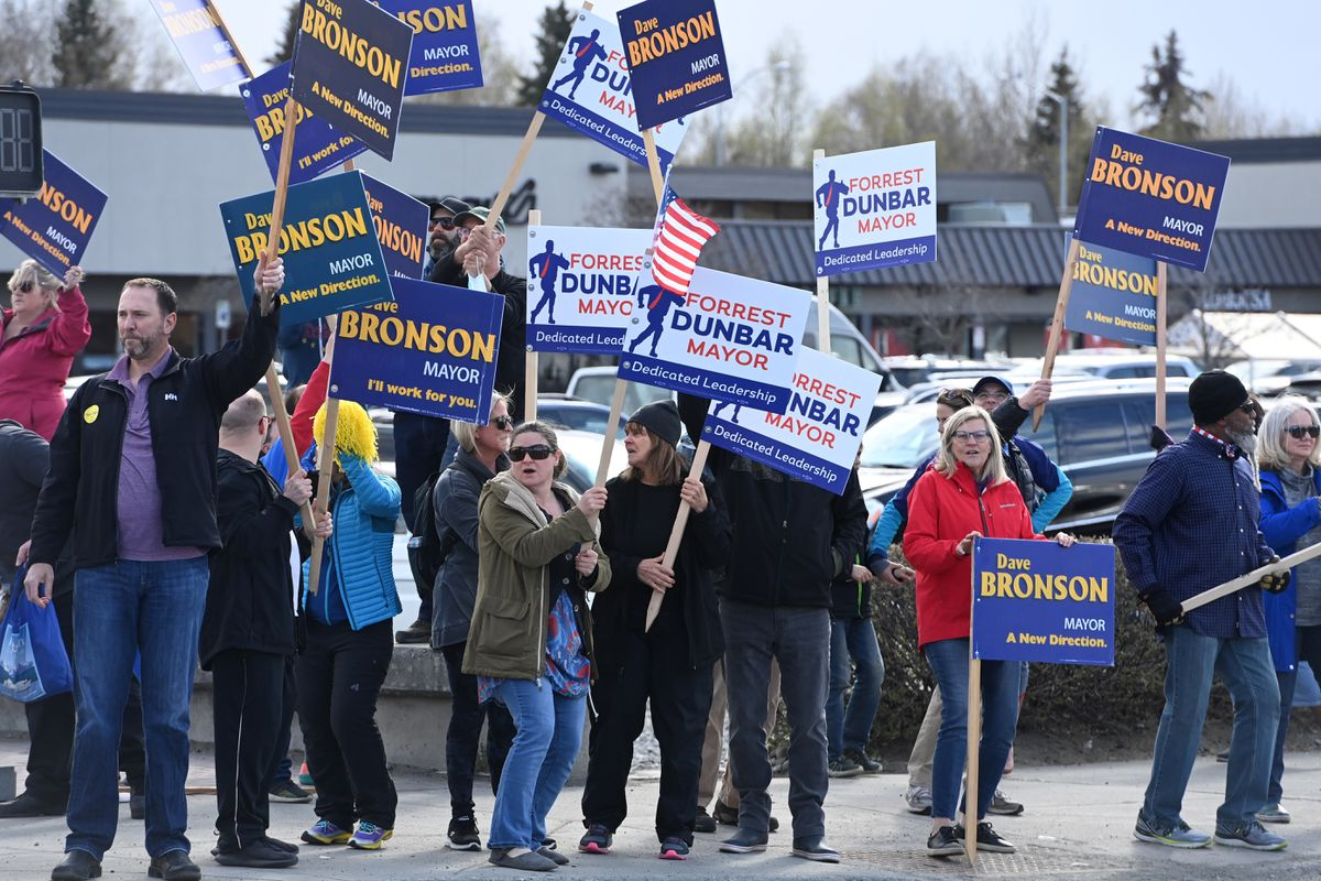 Campaign supporters for both Dave Bronson and Forrest Dunbar share the same corner at Minnesota Drive and Northern Lights Boulevard on Tuesday. (Bill Roth / ADN)