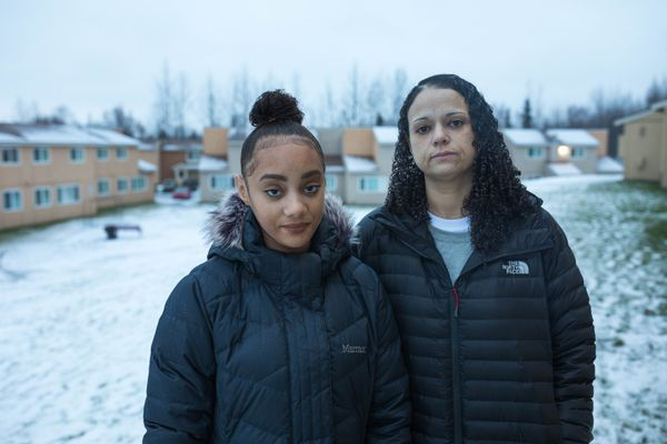 Rebecca Hatley and her daughter Aniah Hatley, 13, stand outside their fire-damaged home Saturday, Dec. 8, 2018 in East Anchorage. Hatley, a dental anesthesia assistant, was sedating a patient on Friday, Nov. 30 when the magnitude 7.0 earthquake struck, causing a gas pipe to break, which started a fire in her apartment. (Loren Holmes / ADN)