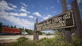 Canadian oil sands city fights 'man camps' in effort to boost population