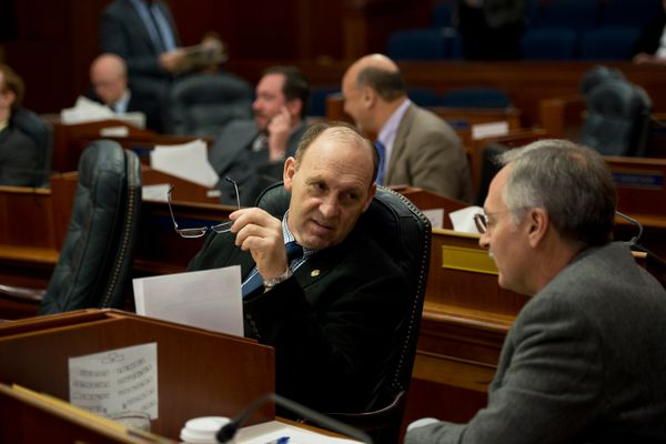 Rep. Gary Knopp, R-Soldotna, talks with Rep. Dave Talerico, R-Healy. The Alaska House of Representatives met for a floor session on January 18, 2017. (Marc Lester / Alaska Dispatch News)