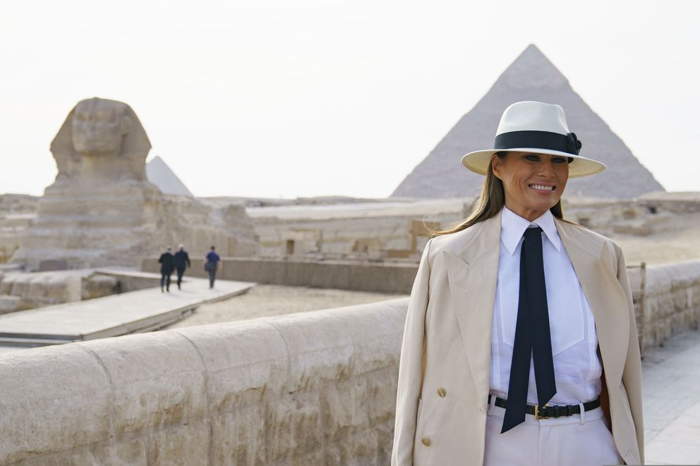 First lady Melania Trump visits the ancient statue of Sphinx, with the body of a lion and a human head, at the historic site of Giza Pyramids in Giza, near Cairo, Egypt, Saturday, Oct. 6, 2018. First lady Melania Trump is visiting Africa on her first big solo international trip. (AP Photo/Carolyn Kaster)