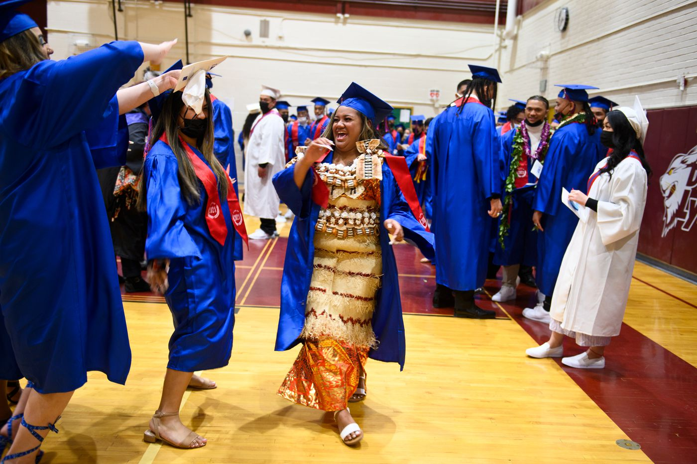 Mele Takafua wore traditional Tongan attire to her East High School graduation. (Marc Lester / ADN)