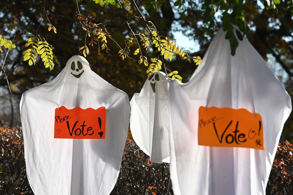 Friendly ghosts near Westchester Lagoon remind people 'Please...Vote! ' on Thursday, Oct. 22, 2020. (Bill Roth / ADN)