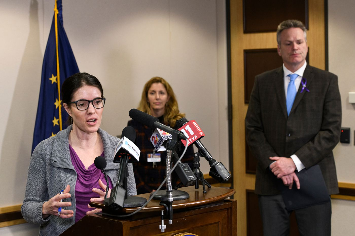 Alaska Chief Medical Officer Anne Zink, left, Alaska Regional Hospital Chief Medical Officer Keri Gardner, and Alaska Gov. Mike Dunleavy discuss the first positive case of coronavirus in Alaska during a press conference in Anchorage on March 12, 2020. (Marc Lester / ADN)