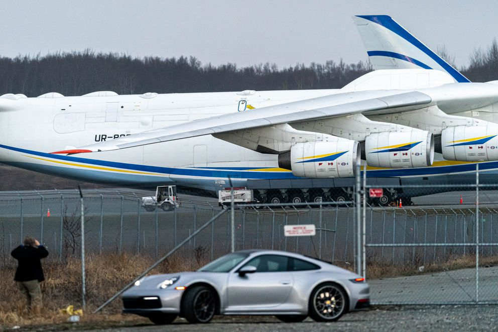 A person takes a photo of the world's largest cargo plane, the Antonov An-225 Mriya, while it is parked at Ted Stevens Anchorage International Airport on Thursday, April 30, 2020. The aircraft was transporting medical supplies to Canada during the COVID-19 pandemic. (Loren Holmes / ADN)