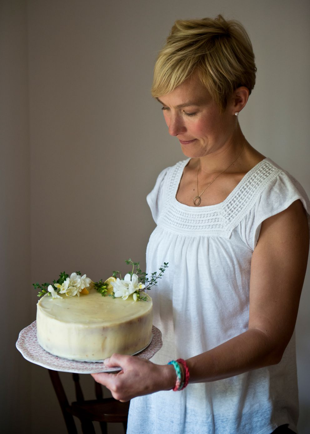 Rosey Fletcher Grunwaldt holds a finished lemon thyme cake in her home. (Marc Lester / Alaska Dispatch News)