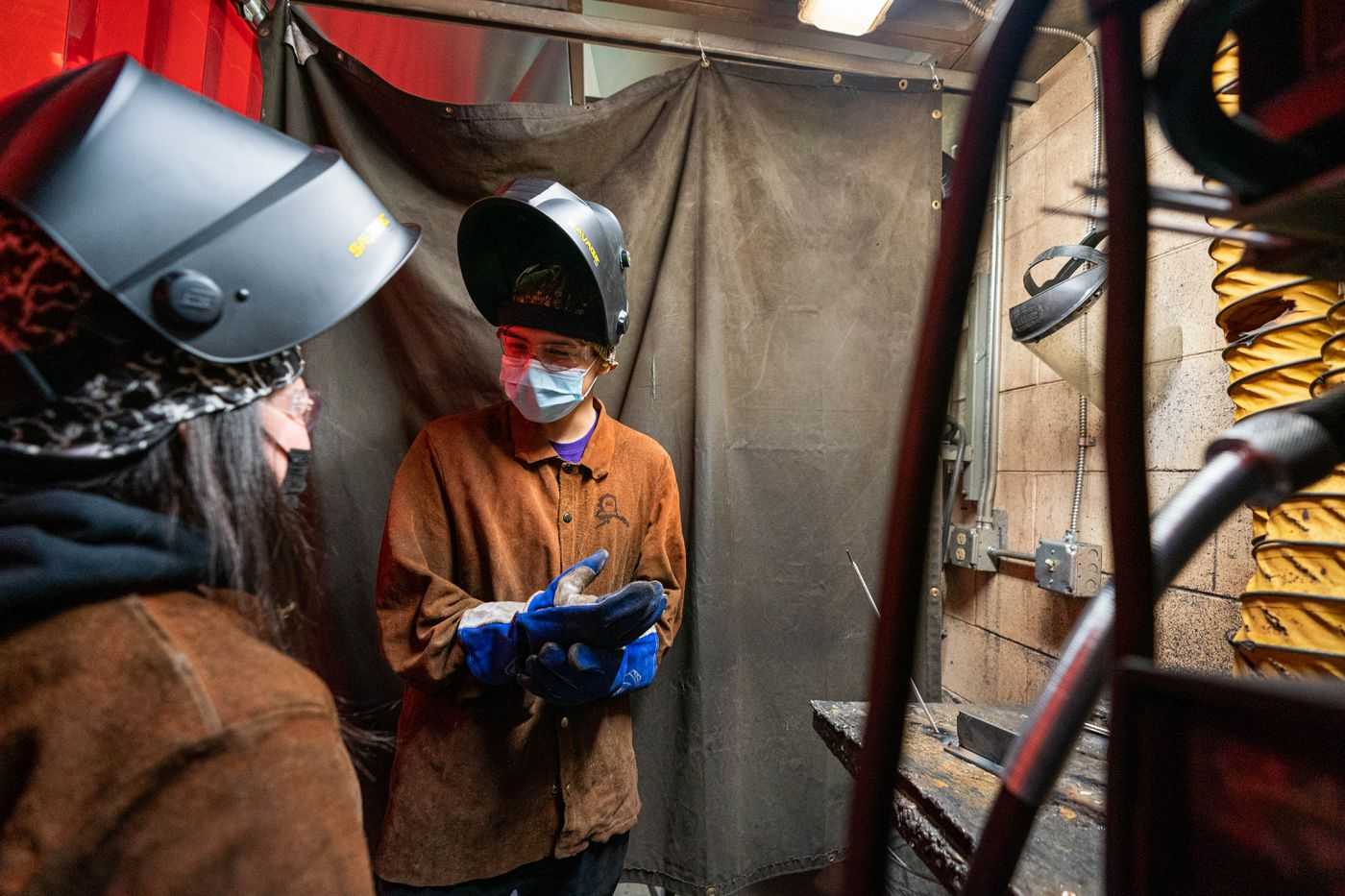 Elsie Kaganak, left, and Luke Isaac practice welding at King Tech High School on April 2, 2021. Kaganak, who is from Scammon Bay, and Isaac, from Marshall, are students at Kusilvak Career Academy. (Loren Holmes / ADN)