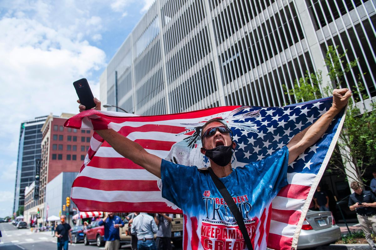 A Trump supporter engages with counter-protesters near the entrance of the BOK Center on Saturday afternoon in Tulsa, Okla. Photo by Amanda Voisard for The Washington Post