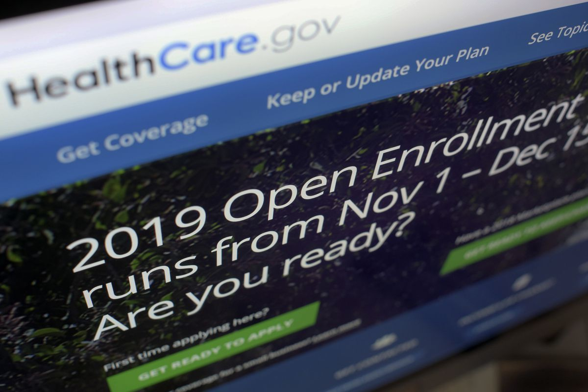 FILE - This Oct. 23, 2018 file photo shows HealthCare.gov website on a computer screen in New York. A federal judge's ruling that the Obama health law is unconstitutional has landed like a stink bomb among Republicans, who've seen the politics of health care flip as Americans increasingly value the overhaul's core parts, including protections for pre-existing medical conditions and Medicaid for more low-income people. (AP Photo/Patrick Sison)