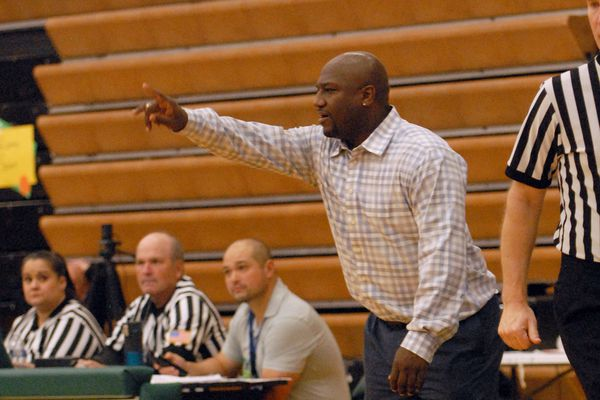 Jocquis Sconiers coaches the Chugiak boys basketball team during a game on Dec. 13 against Tikigaq at Service High in Anchorage. On Thursday, Sconiers was fired by Chugiak after it was revealed he commited a recruiting violation, then lied to administrators and state high school activities officials in an attempt to cover his actions. (Matt Tunseth / ADN)