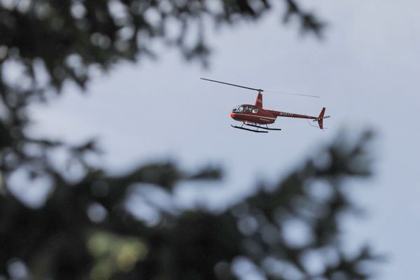 A private helicopter crew hiredby the Soltis family was involved in the search for Michael Soltis near Eagle River on Wednesday, June 20, 2018. (Loren Holmes / ADN)