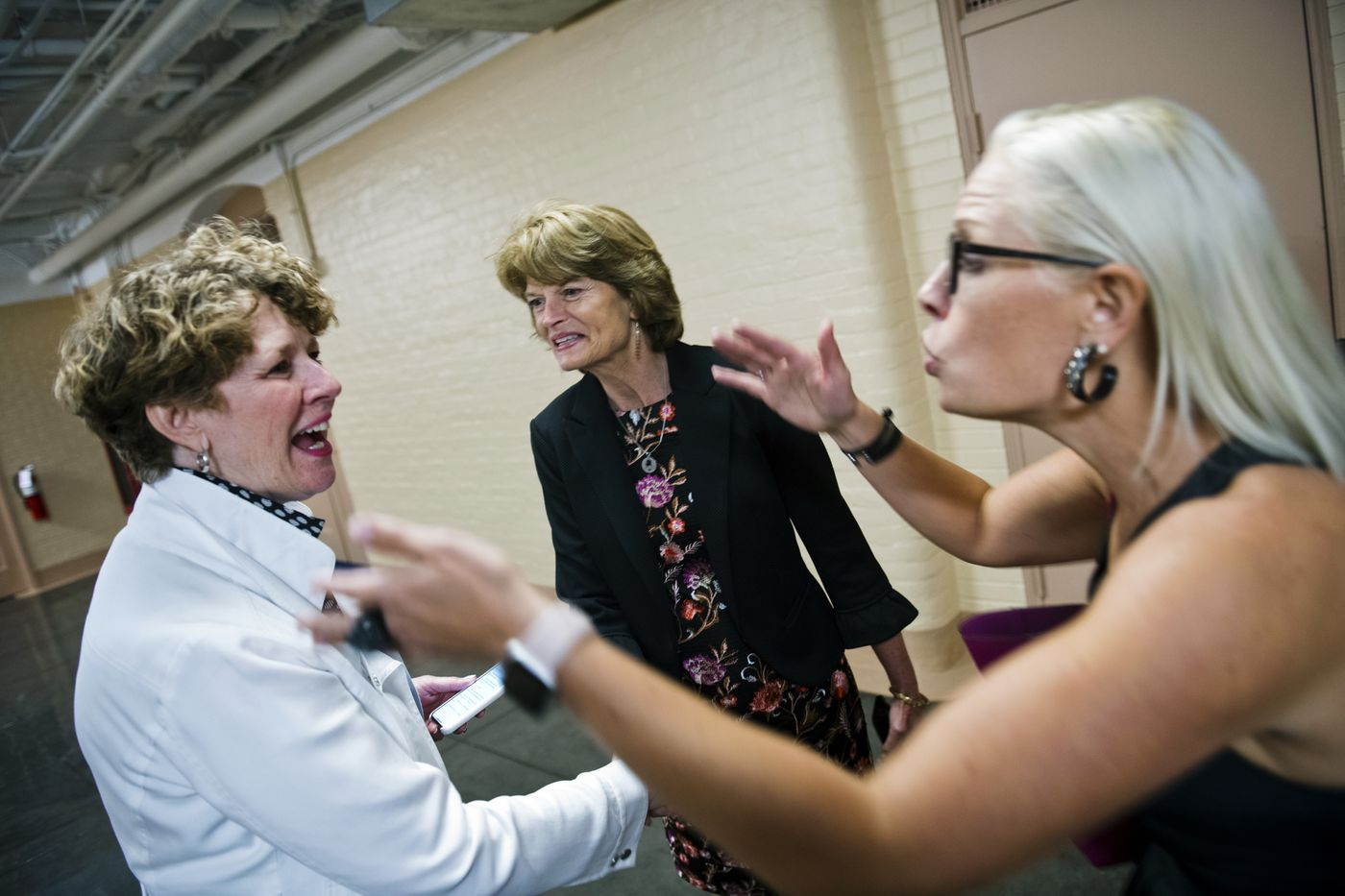 Rep. Susan Brooks, R-Indiana, greets Sen. Lisa Murkowski and Sen. Kyrsten Sinema, D-Arizona, as they walk to Murkowski's hideaway office in the Capitol on June 18, 2019. Murkowski said the meeting, which included another Democratic representative, was part of her effort to build relationships across party lines in Congress. (Marc Lester / ADN)