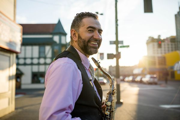 Saxophonist Bill Hauser on Anchorage's 4th Avenue on Friday, Aug. 16, 2019. Hauser used to busk on this street. (Loren Holmes / ADN)