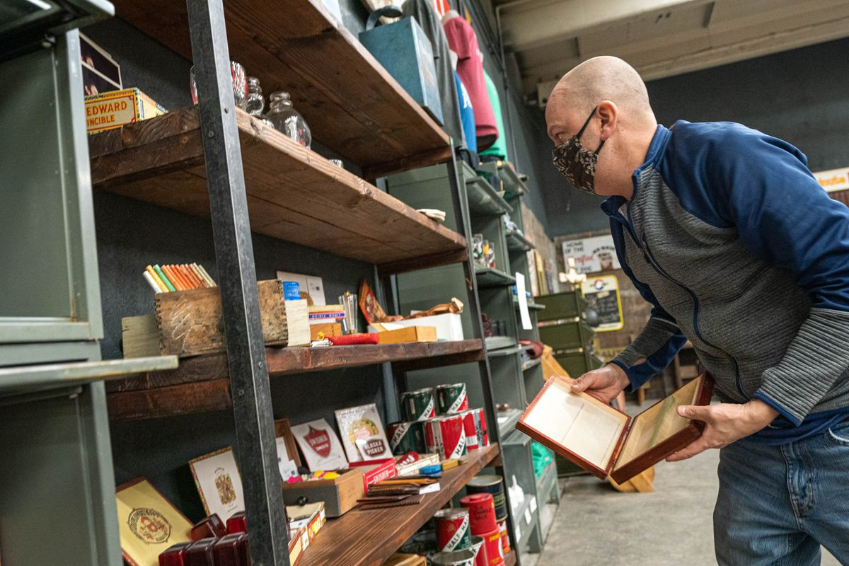 Owner Kelly Turney prepares for the Friday opening of his antique store, Alaska Picker, on Thursday, April 23, 2020 in Palmer. The store has been closed for a month due to concerns over the coronavirus. (Loren Holmes / ADN)
