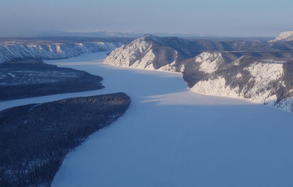 The Yukon River downstream of Slaven's Roadhouse, showing Woodchopper Bluff, in early February, 2020. (Photo by Adam Bucki)