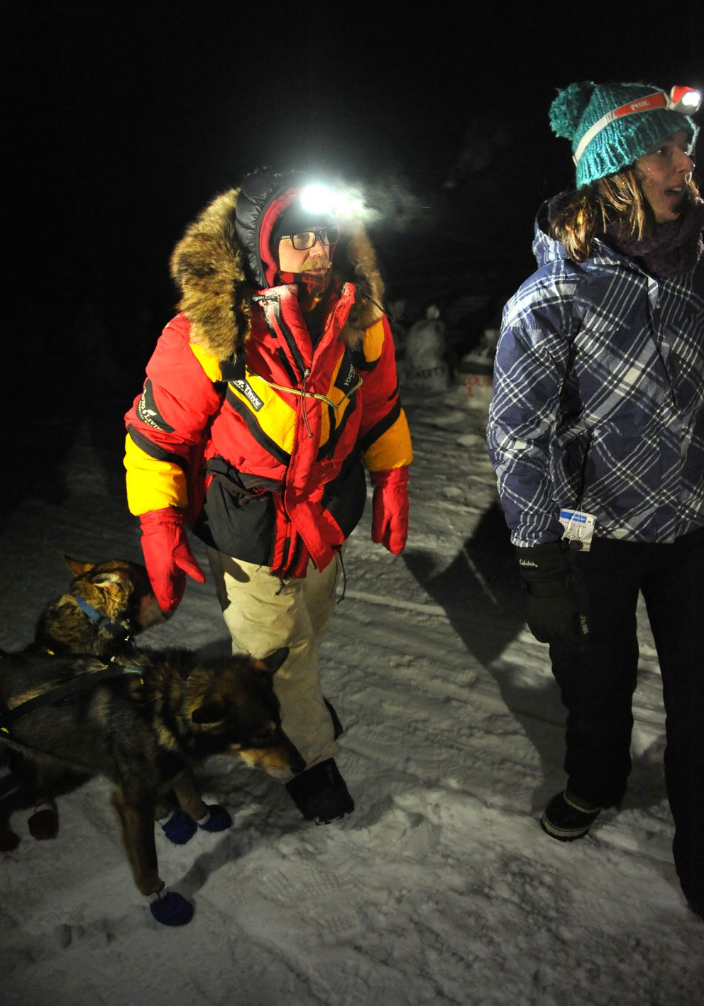 Mitch Seavey looks for his parking spot after arriving in White Mountain in first place during the 2017 Iditarod Trail Sled Dog Race on Monday. (Bob Hallinen / Alaska Dispatch News)