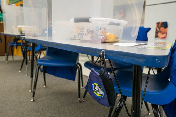 A face mask hangs from a desk in Rhiana Gay's kindergarten classroom at Creekside Park Elementary on Friday, Jan. 15, 2021. Ms. Gay's students will return to in-person learning on Tuesday, Jan. 19. (Loren Holmes / ADN)
