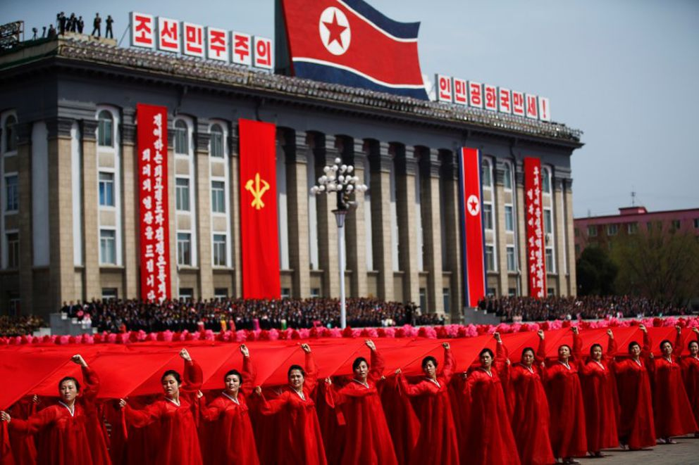 Attendees carry sheets in colours of the national flag of North Korea during a military parade marking the 105th birth anniversary of country's founding father Kim Il Sung, in Pyongyang April 15, 2017. REUTERS/Damir Sagolj
