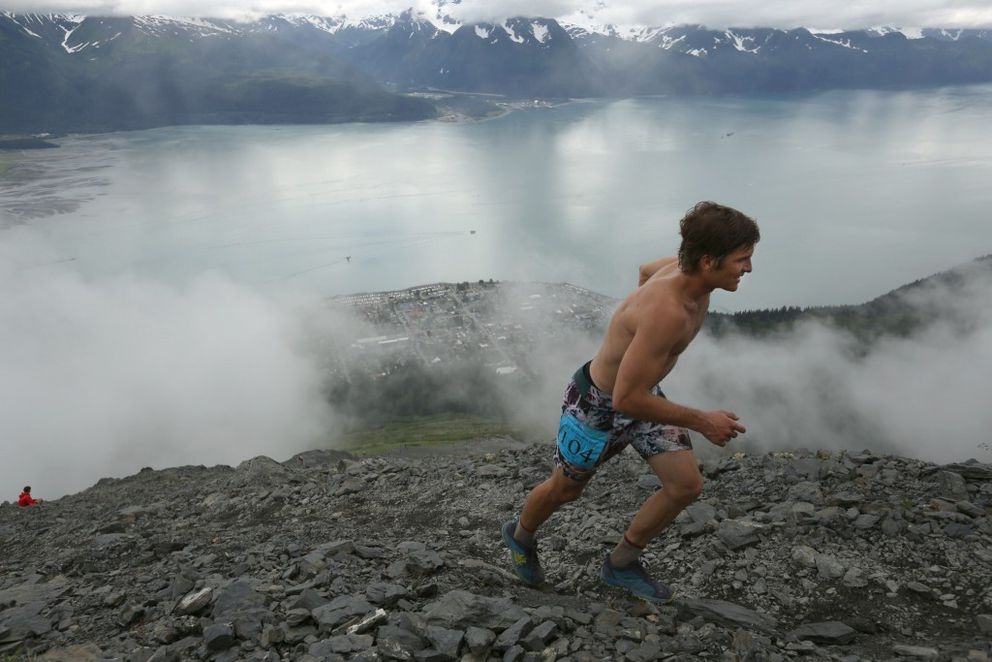 David Norris approaches the top of Mount Marathon on his way to a course-record 41:26. (Loren Holmes / Alaska Dispatch News)