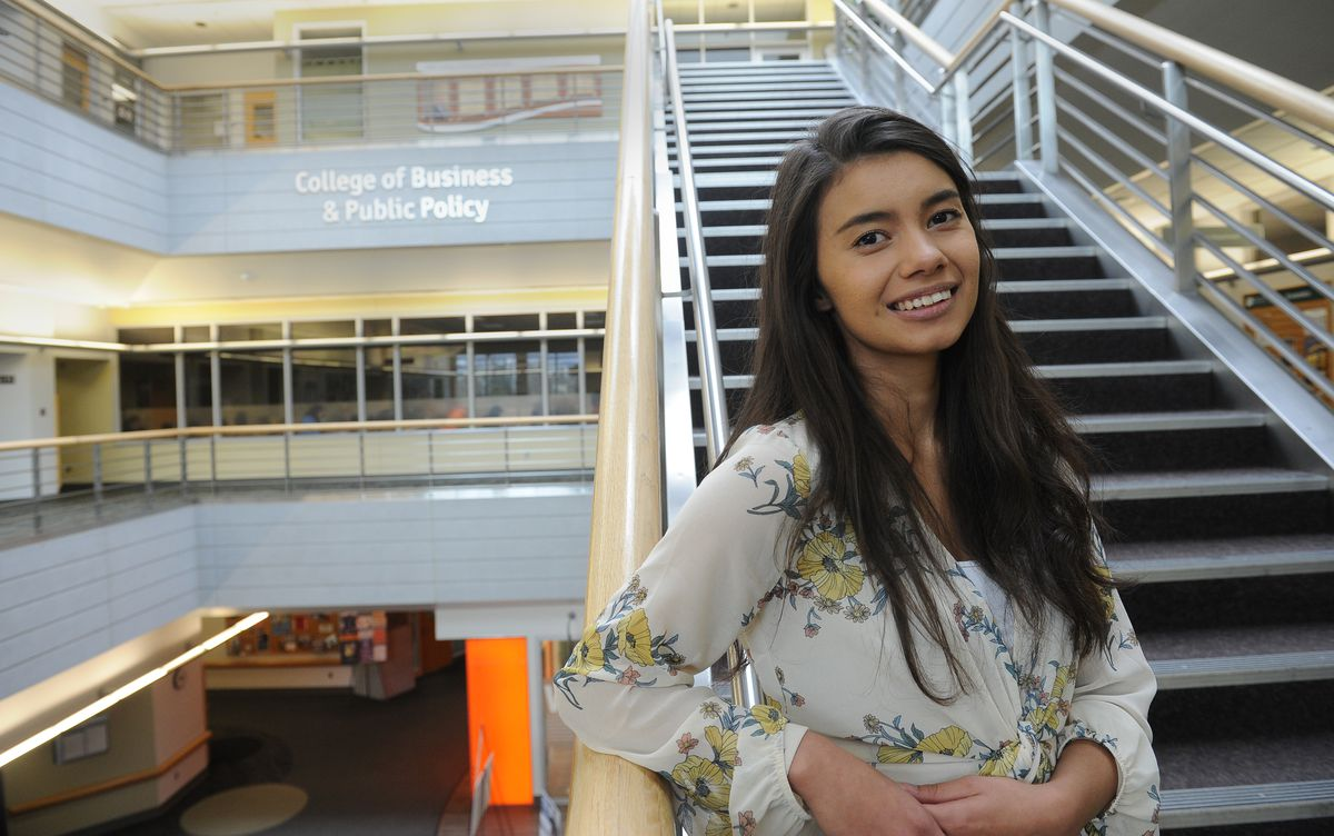 Lyndea Kelleher who will be graduating from UAA this Sunday poses for a photograph in the Rasmuson Building on the UAA campus in Anchorage, AK area on Friday May 4, 2018. (Bob Hallinen / ADN)