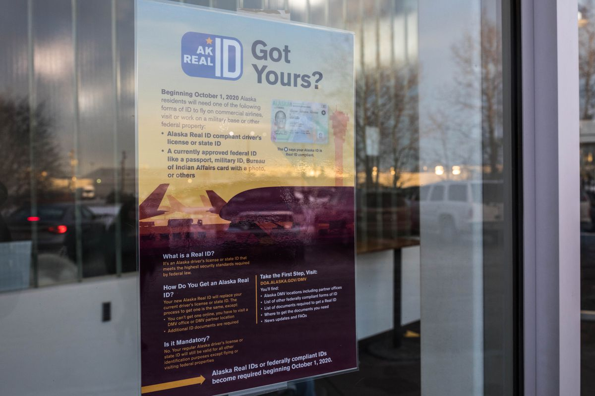 A poster informs people of the availability of the Alaska Real ID on Jan. 2, 2019 at the Anchorage DMV office. (Loren Holmes / ADN)