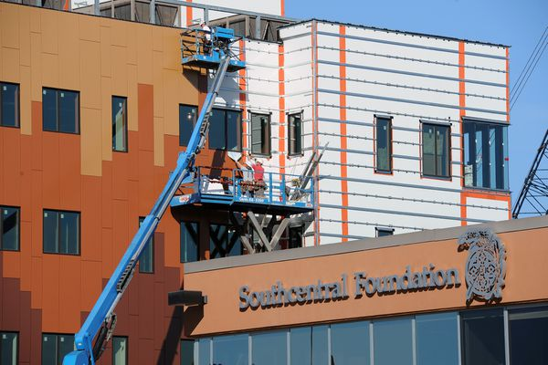 The five-store Southcentral Foundation Children's Dental Clinic rises above the Southcentral Foundation administration building on Friday, September 8, 2017, on the Alaska Native Health Campus. The clinic, which will also include OB/GYN and Behavioral Health Services, is slated to open a year from now. (Erik Hill / Alaska Dispatch News)