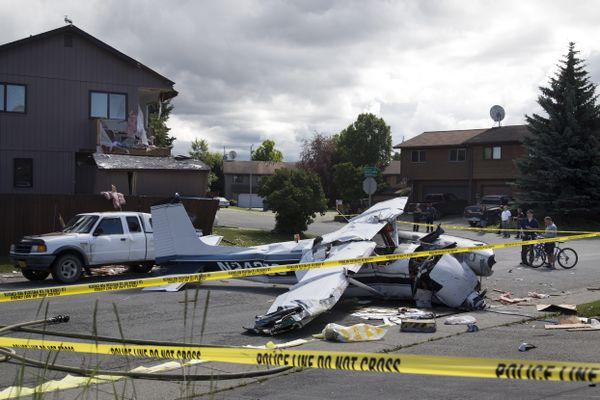 A small plane clipped a corner of a duplex on the corner of Orion Circle and Cosmic Circle and ended up in the middle of Orion Circle just south of Balto Park in west Anchorage, Alaska on Sunday, July 9, 2017. (Rugile Kaladyte / Alaska Dispatch News)
