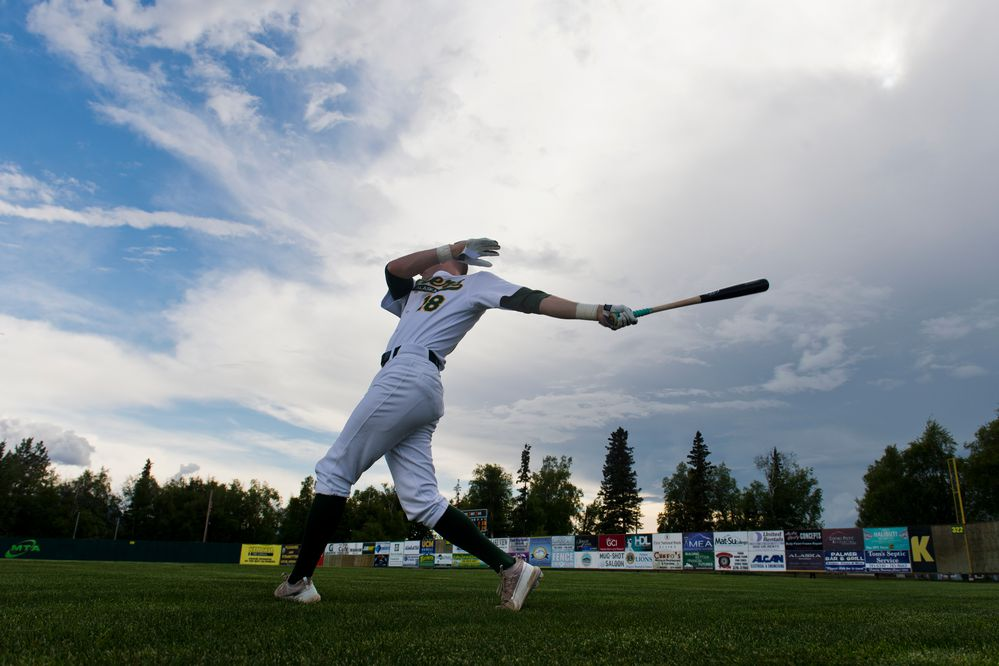 Sam Thompson, of the Miners, takes some practice swings before the game begins. The Alaska Baseball League's season opened on June 5, 2019, when the Mat-Su Miners hosted the Chugiak-Eagle River Chinooks at Hermon Brothers Field in Palmer. (Marc Lester / ADN)