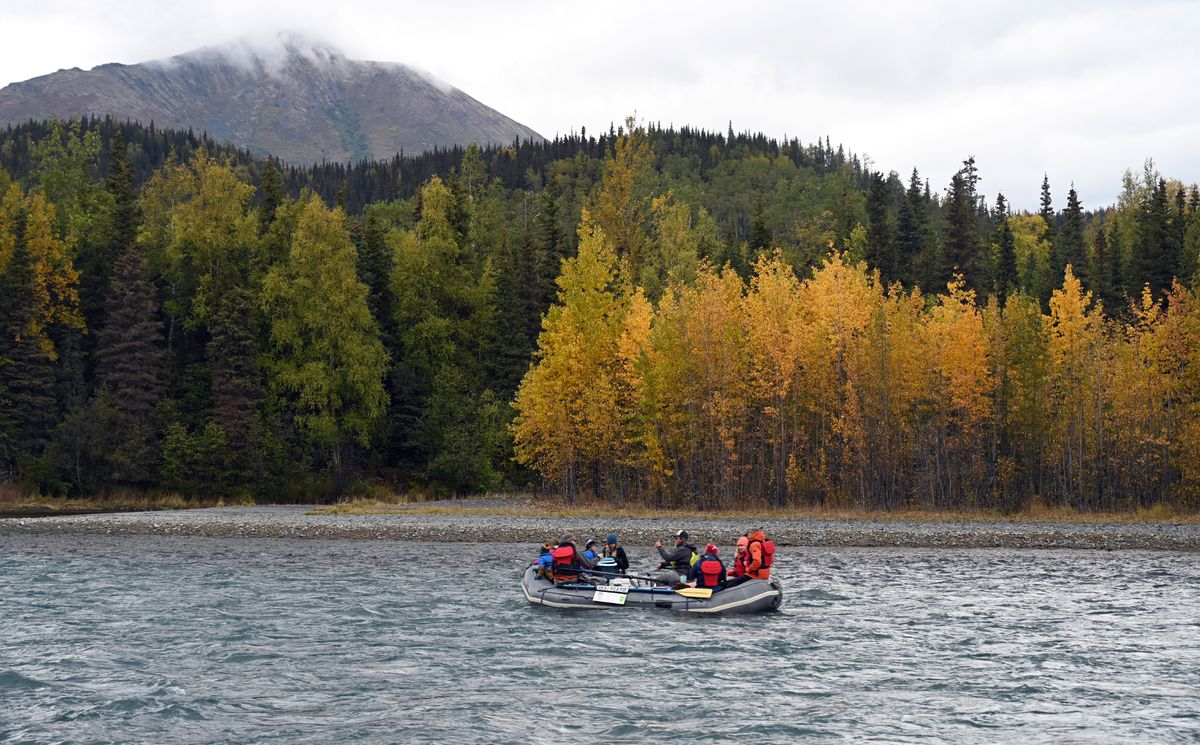 A raft floats the Kenai River Sept. 15, 2020. The autumn colors are beginning to develop in some locations in Southcentral Alaska. (Anne Raup / ADN)