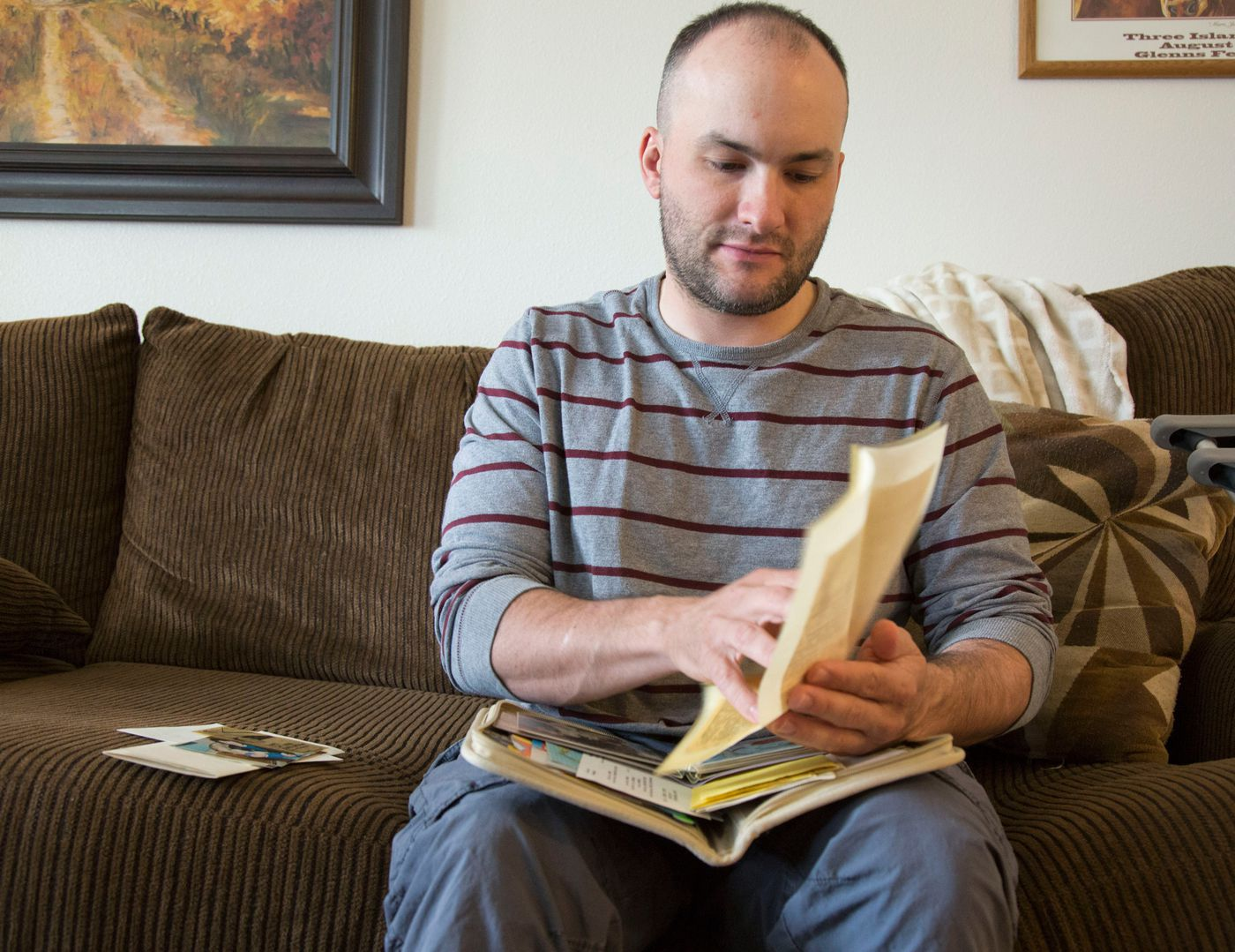 Benjamin Tveidt keeps the few clues of his Anchorage history in a little notebook — a couple of newspaper clippings, a letter from his foster mother and photos when he lived with her, and his baby ID from the hospital. Now living in Boise, Idaho, Tveidt is trying to piece together his family history. (Katherine Jones / Idaho Statesman)