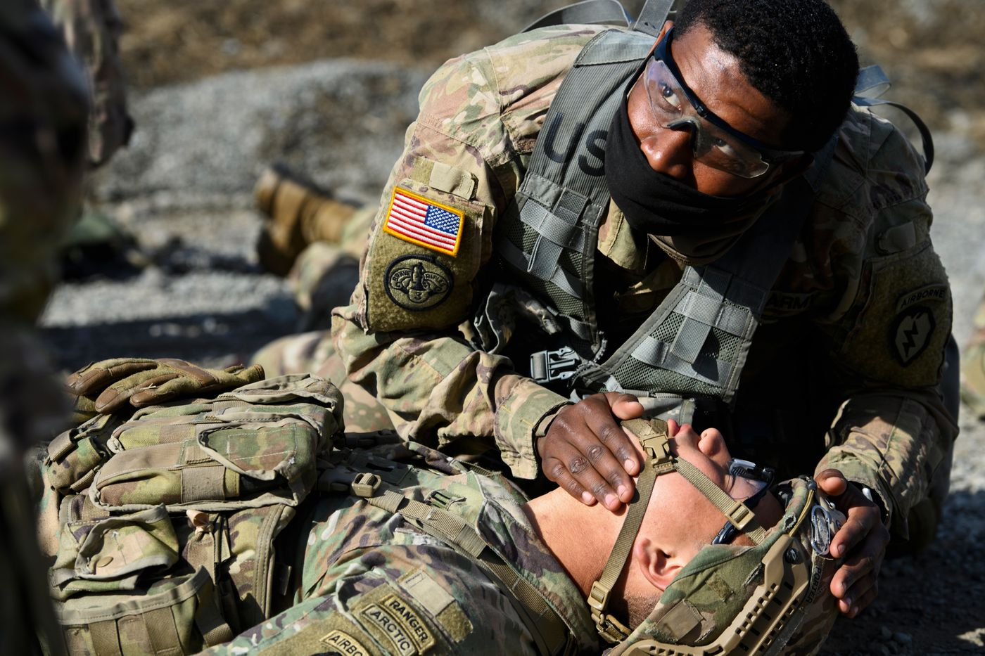 Sgt. Tamir Laister, top, works at one of the medical testing stations with 1st Lt Tim Porter. (Marc Lester / ADN)