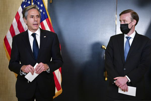 Secretary of State Antony Blinken, accompanied by National Security Adviser Jake Sullivan, right, talks to the media after a closed-door morning session of US-China talks in Anchorage, Alaska on Friday, March 19, 2021. (Frederic J. Brown/Pool via AP)