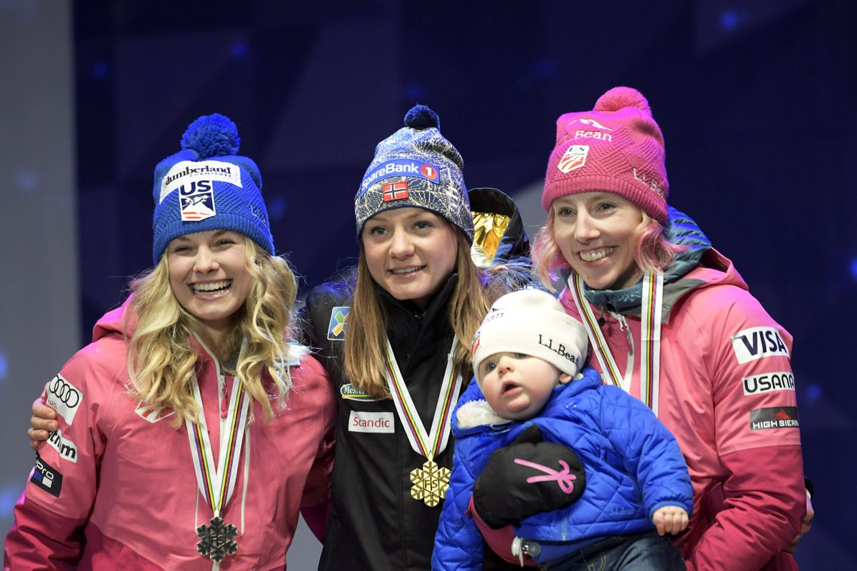 Winner of the ladies cross-country sprint, (l-r) 2nd placed Jessica Diggins of USA, winner Maiken Caspersen Falla of Norway and 3rd Kikkan Randall of USA, with her baby, during medal ceremonies of FIS Nordic World Ski Championships 2017 in Lahti, Finland. (LEHTIKUVA/Markku Ulander via REUTERS)