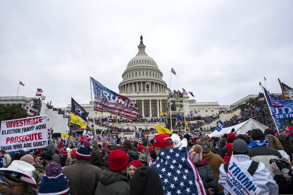 Supporters of President Donald Trump rally at the U.S. Capitol on Wednesday, Jan. 6, 2021, in Washington. (AP Photo/Jose Luis Magana)